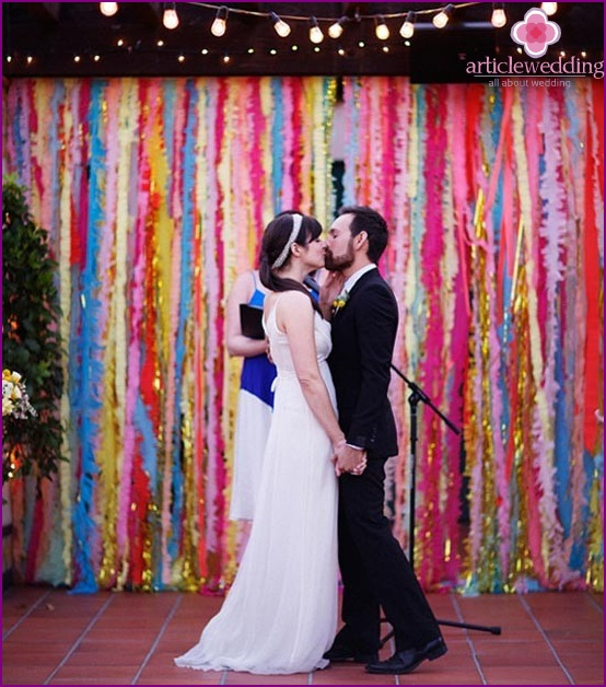 Newlyweds on the background of bright garlands