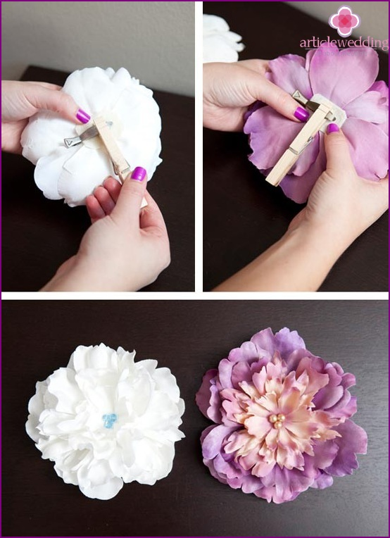 Glue the clip on the back of the flower and hold it to dry