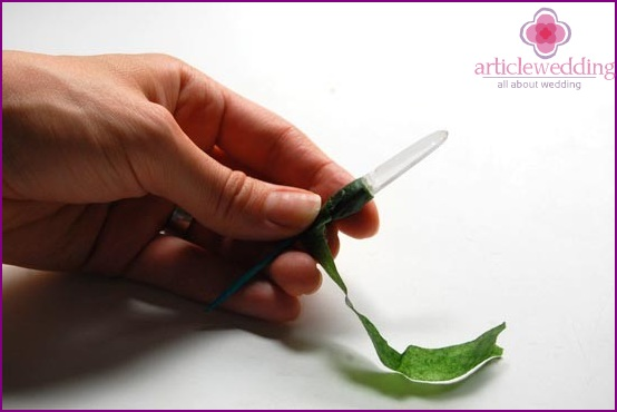 Wrap the foot of the buttonhole with floral tape