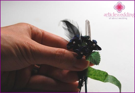 Add greens to the boutonniere
