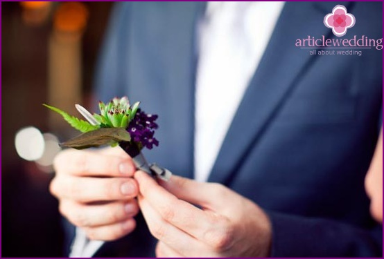 Symbolic boutonniere with crystal and greenery
