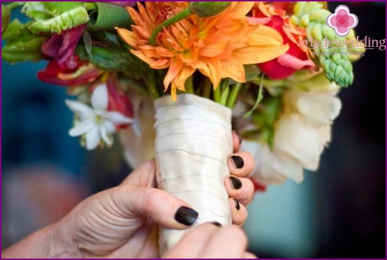Wrap a bouquet with satin ribbon.
