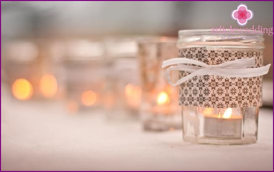 Delicate candle holder from a can