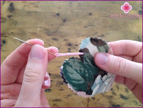 We begin to sew two pieces of fabric