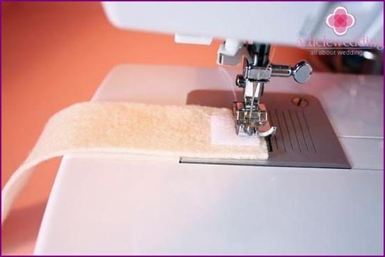 Sew Velcro to the felt