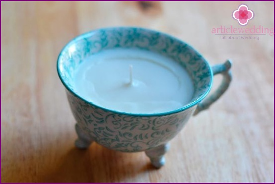 Fashionable candles in cups