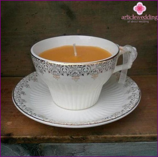 Candles in vintage cups