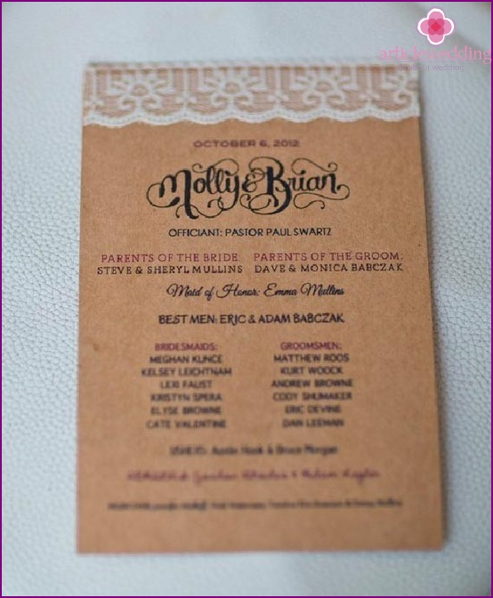 Wedding program decorated with lace ribbon