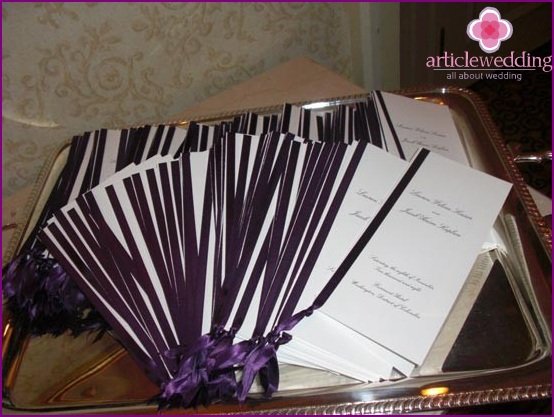 Wedding program decorated in celebration color.