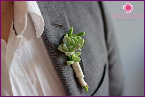 Attach the boutonniere to the jacket