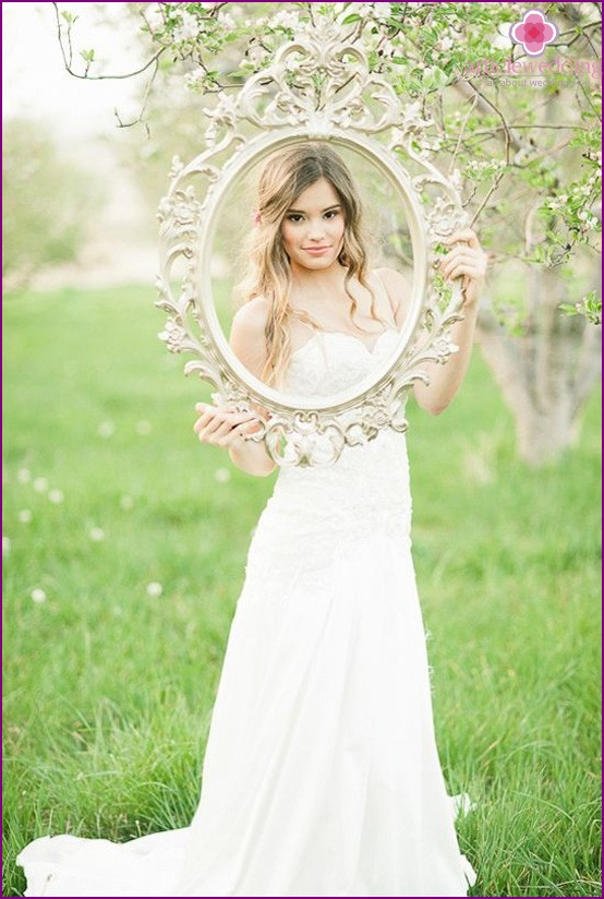Bride at a photo shoot with a frame