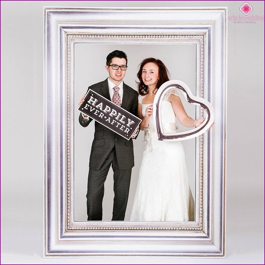 The bride and groom in the original photo zone