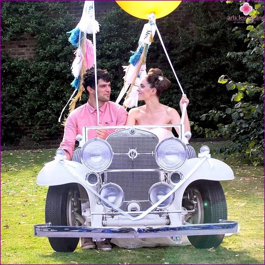 Wedding photo zone with a car