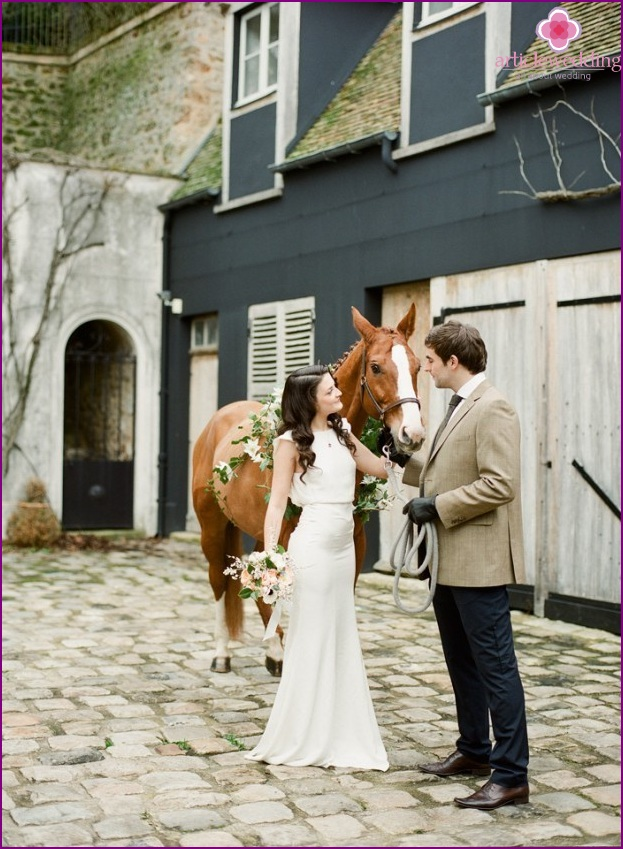 Horse ride at a Chanel-style wedding