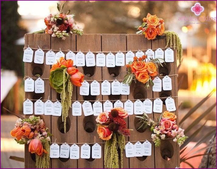 Escort card on a stand with flowers