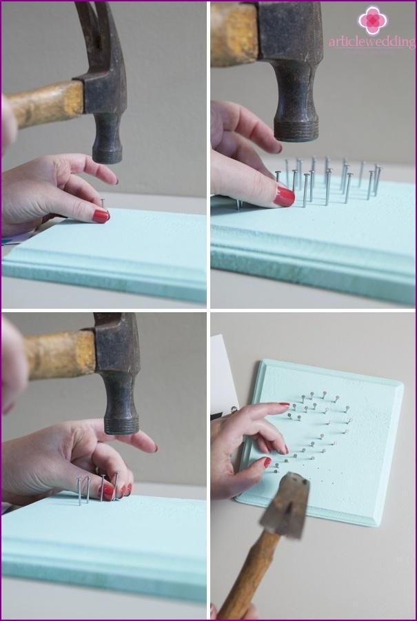 Drive nails into holes