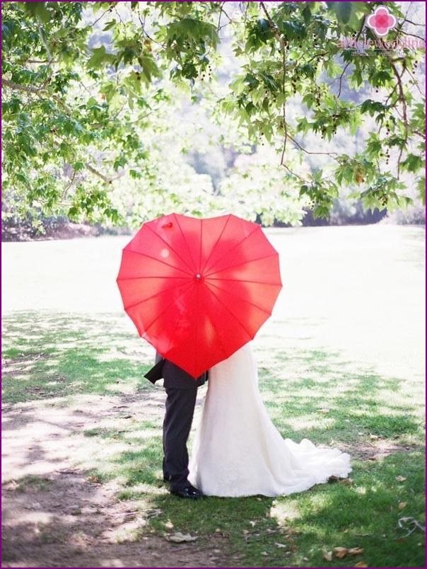 Red umbrella for a photo shoot