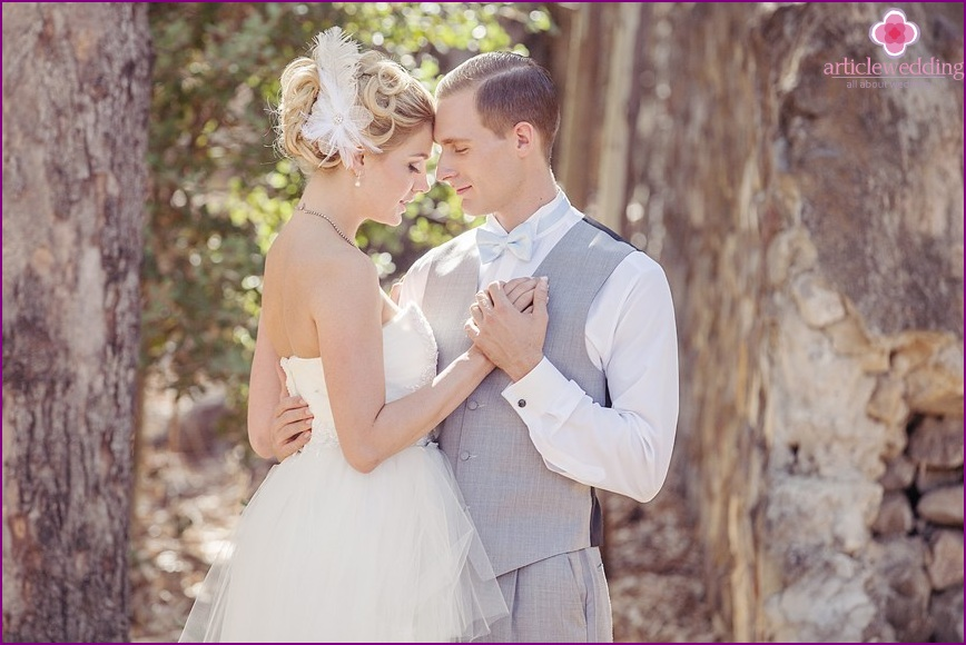 The image of the newlyweds in the style of a fairy tale Cinderella