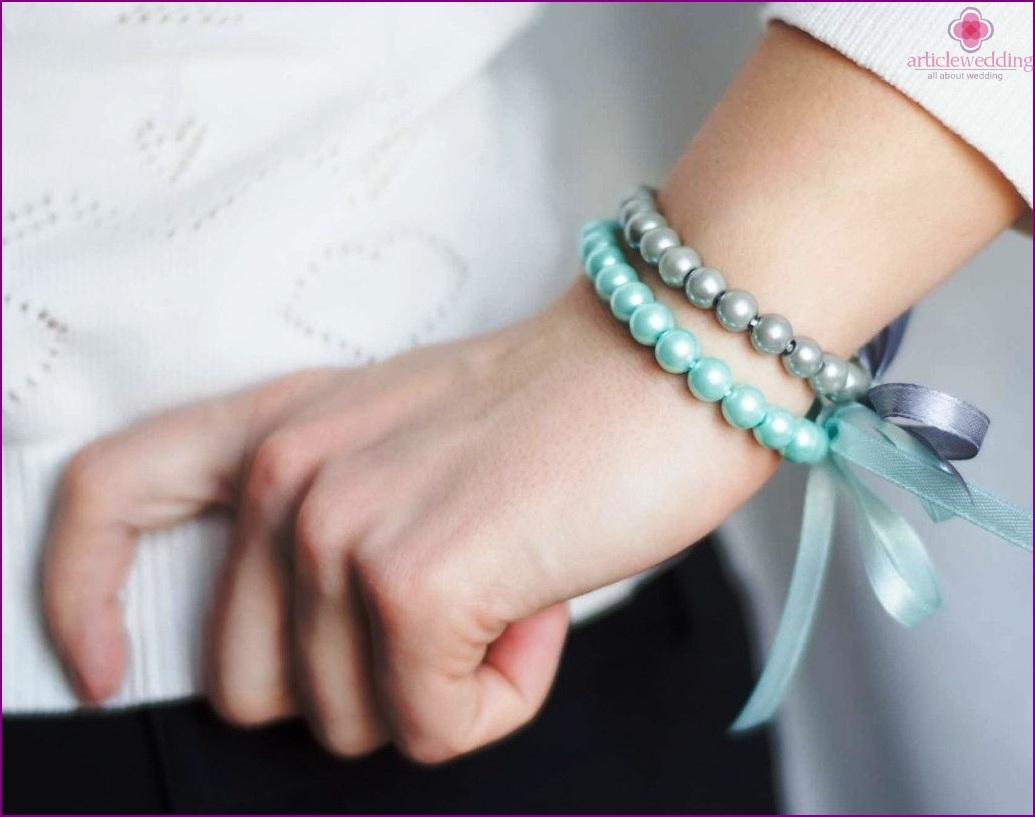 Stylish beads for an arm bracelet