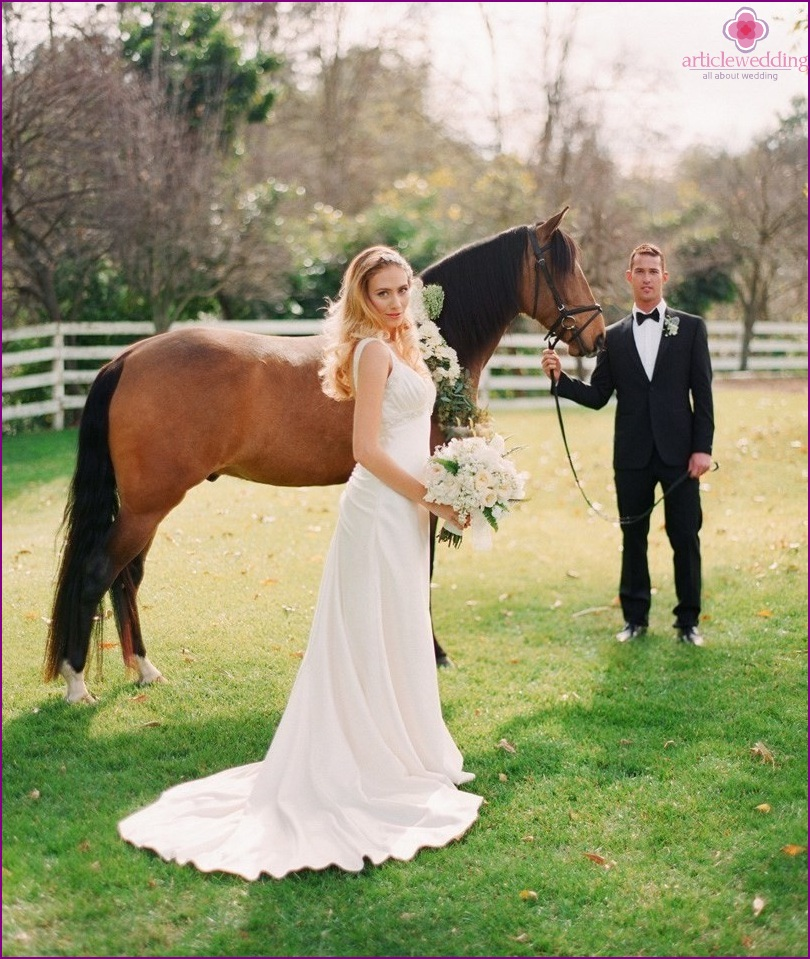 Newlyweds with a horse