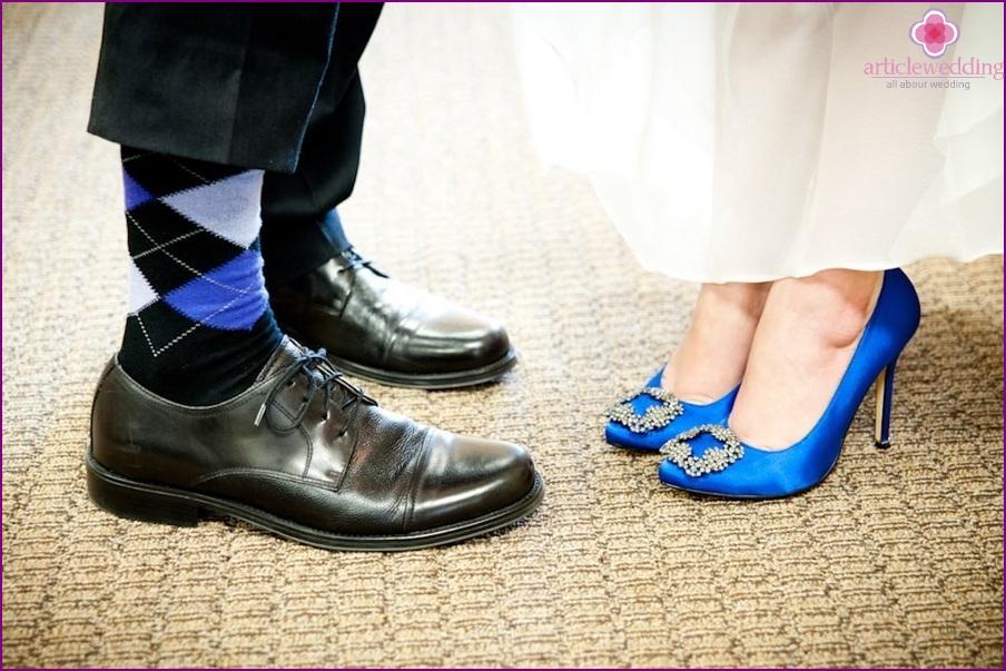 Blue bride shoes and groom socks
