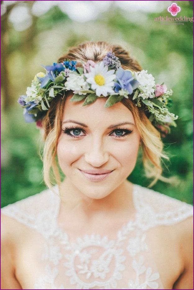 Stylish wreath of fresh flowers
