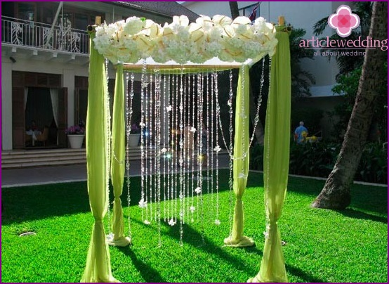 Decor of a wedding arch with glass beads
