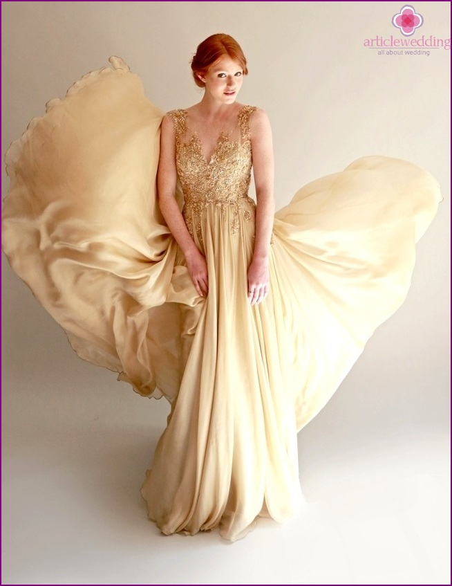 Dress of the bride in gold color