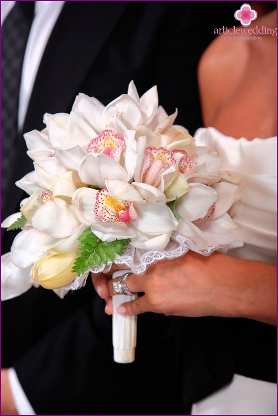 Moody orchids in the bride's bouquet