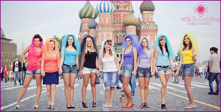 Multi-colored headdress on bridesmaids