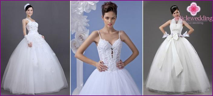 A puffy strapless wedding dress