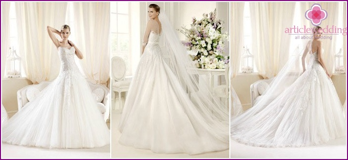 Voluminous wedding dress with a train