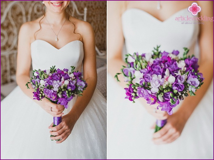 Live purple freesia in a newlywed bouquet
