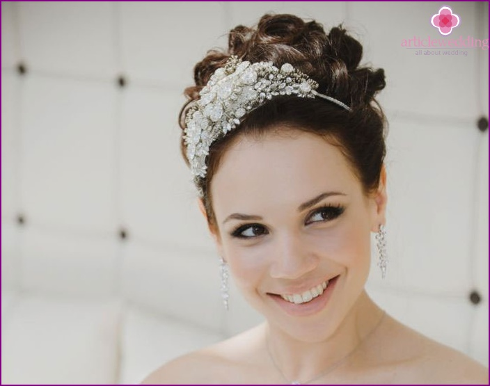 A combination of bridal styling bun and tiaras