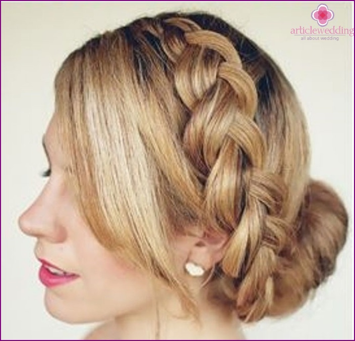 Hairstyle of the bride with a braided braid
