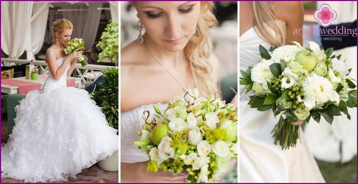 Hochzeitsblumenbraut mit grünen Früchten