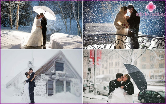 The bride and groom on the background of falling snow