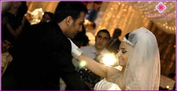 Loving Armenian bridegroom with bride