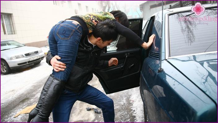 Bride kidnapping a car