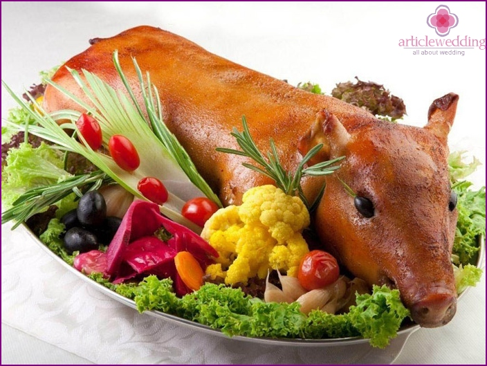 Baked young pig at a wedding table
