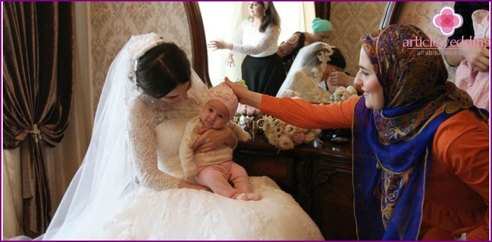Chechen spouse holds baby