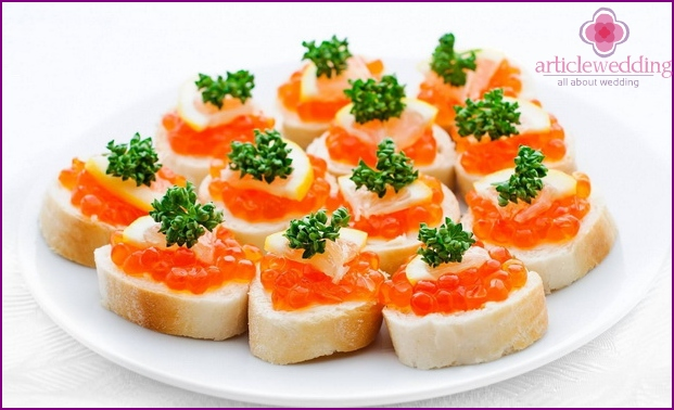 Holiday sandwiches with red caviar