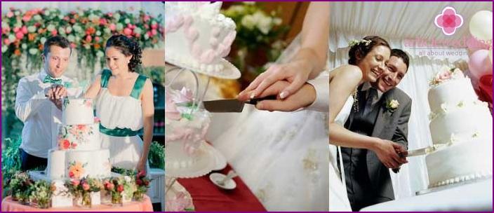 Good omen - a joint cut of a wedding cake