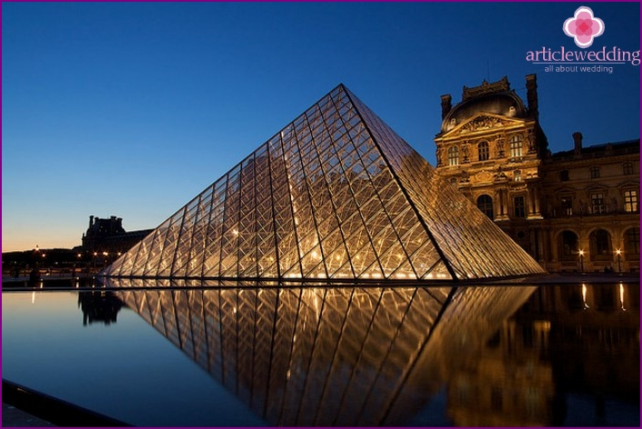 The ancient Louvre Museum and the modern pyramid of Paris