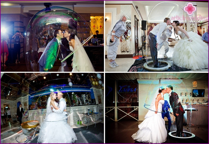 Kiss the bride and groom in a huge soap ball