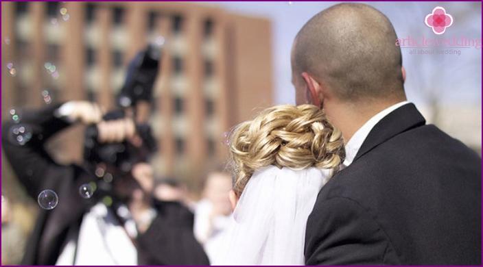 Amateur photographer at a budget wedding