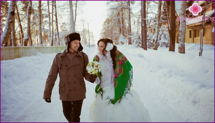 Newlyweds in a Russian wedding style