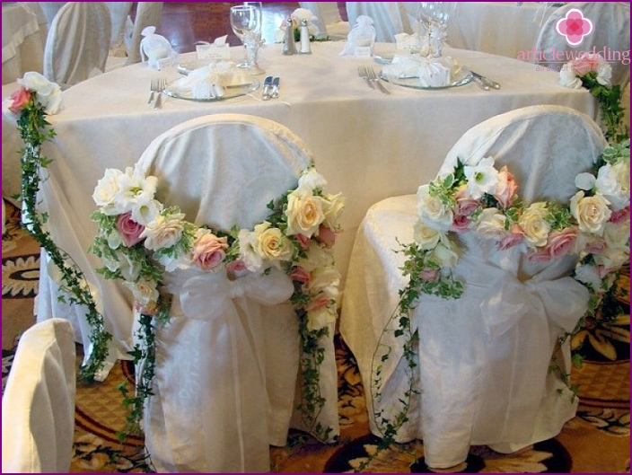 Stylish design of chairs with floral arrangements