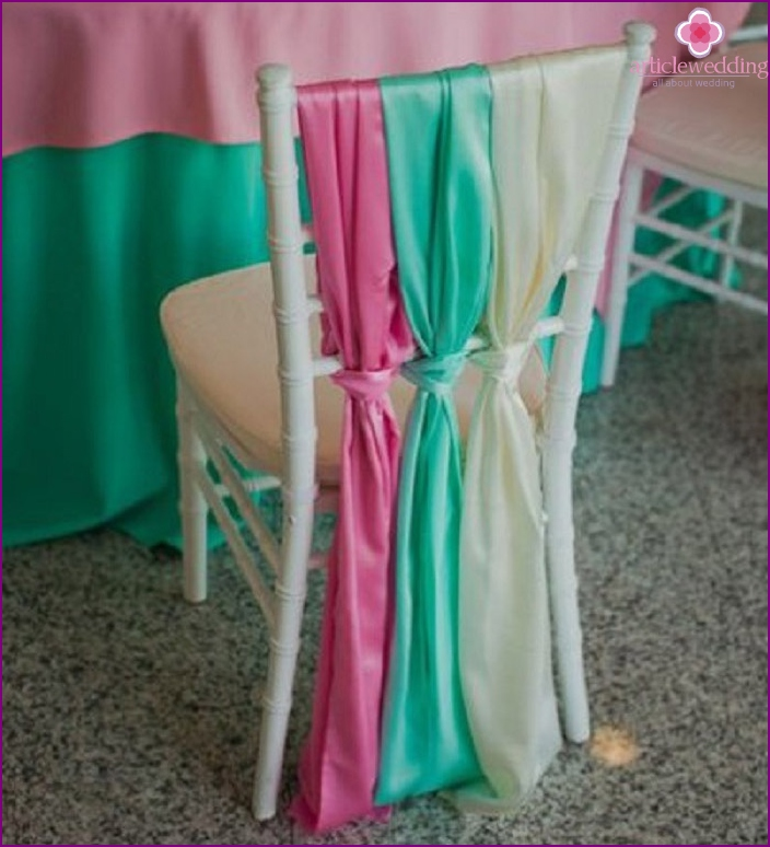 Ribbons look perfect on plastic chairs