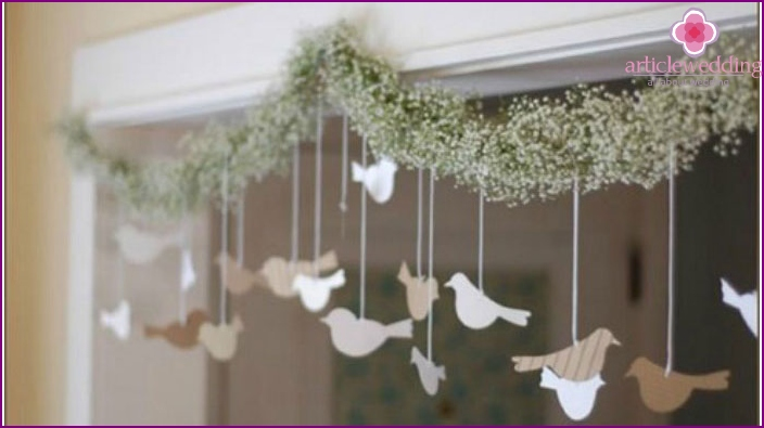 Garland with paper doves for a wedding